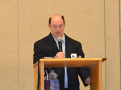 D. Egan at podium